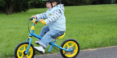 Thumb child learning ride bike